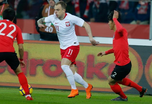 Kamil Grosicki (C) i Yong Lee (P)